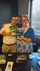 Karl and Angela Robb with Karl's book and Parky the Raccoon.
